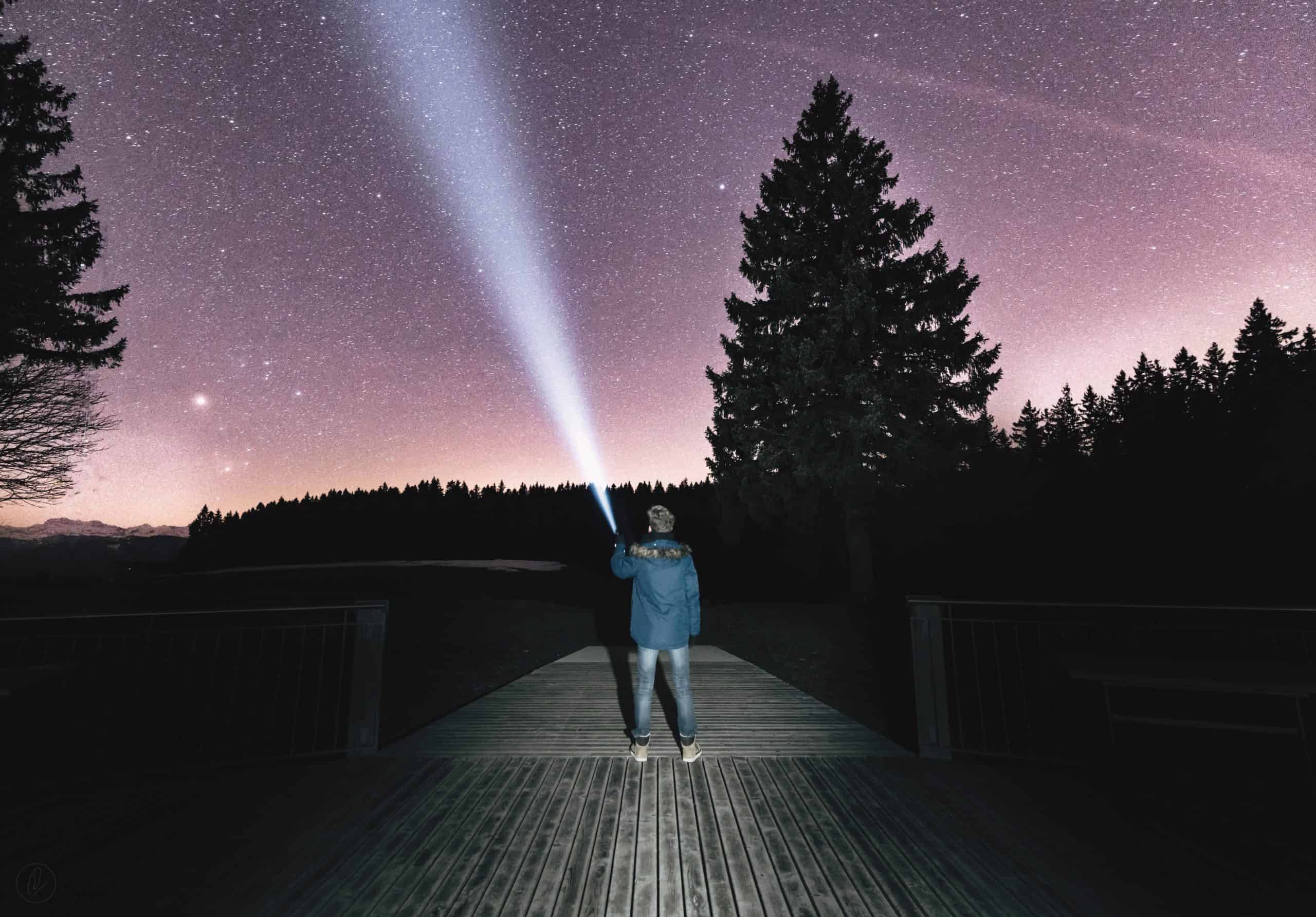 Man looking to the sky for aliens